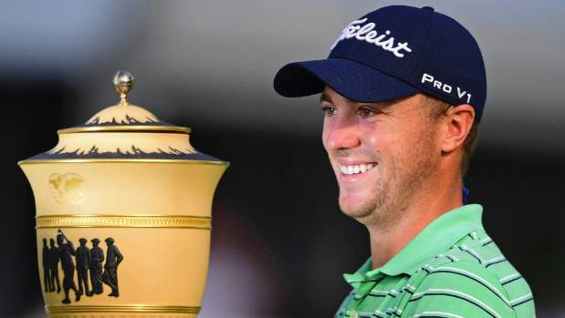 Justin Thomas poses with the Gary Player Cup trophy after holding his nerve to win the Bridgestone Invitational