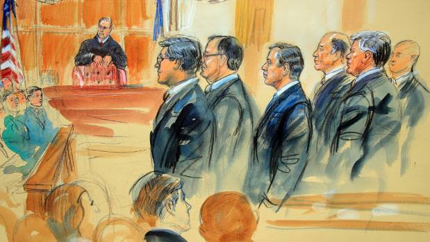 A courtroom sketch depicts Paul Manafort fourth from right standing with his lawyers in front of US district Judge