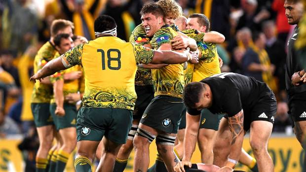The Wallabies players celebrate victory after their 23-18 win over the All Blacks in Brisbane last October.