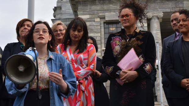Young Labour rainbow member Teri O'Neill, foreground, speaks to a crowd of about 60 people gathered at Parliament, in ...