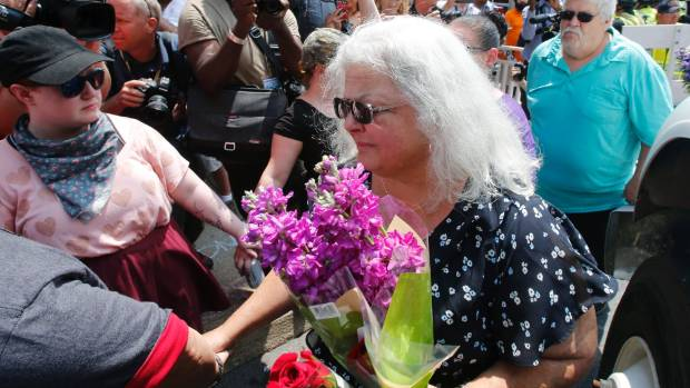 Susan Bro, the mother of Heather Heyer who was killed during last year's Unite the Right rally, placed flowers at the ...