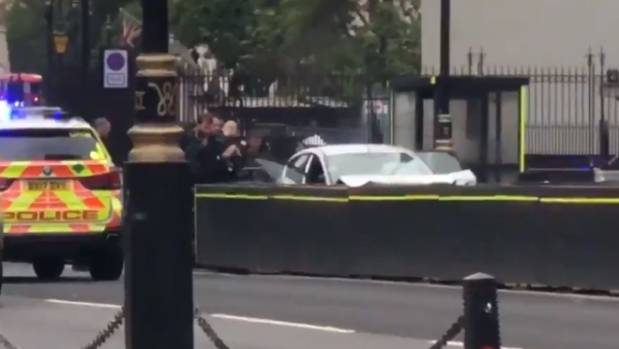 Vehicle  crashes into barriers outside Houses of Parliament, driver arrested at scene