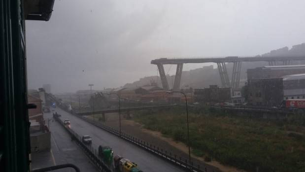 Bridge collapses in Italy during heavy storm, crushing cars