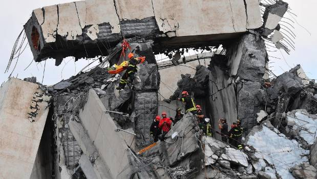 Search for survivors after Italian motorway collapse kills 26