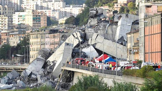 Rescuers work to recover injured people after the Morandi highway bridge collapsed in Genoa northern Italy