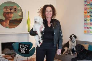 Fiona Tomlinson and her three dogs all share the house in Napier.