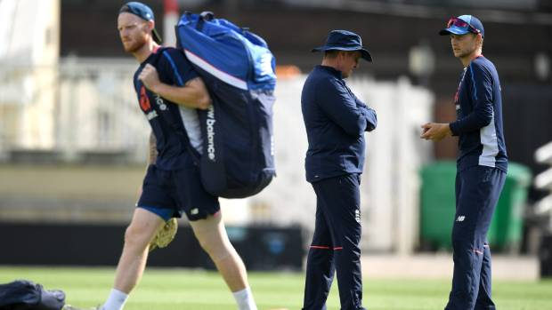 England captain Joe Root right speaks with coach Trevor Bayliss as Ben Stokes walks to the nets at training during the