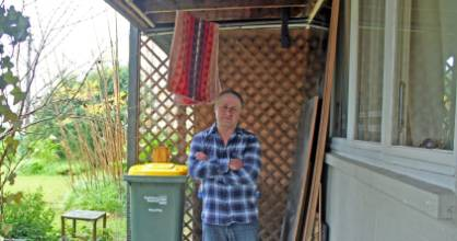 Ray Sykes under his washing line outside his Housing New Zealand property in Northcote.