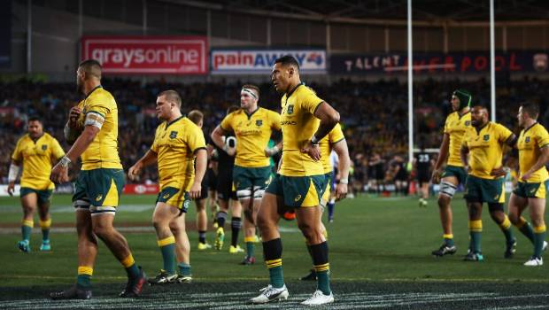 The All Blacks race in to score and Wallabies fullback Israel Folau and his team-mates head for the posts.