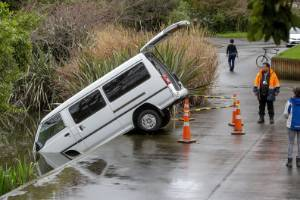 In the pouring rain, a driver accidentally drove into a pond at Massey University.
