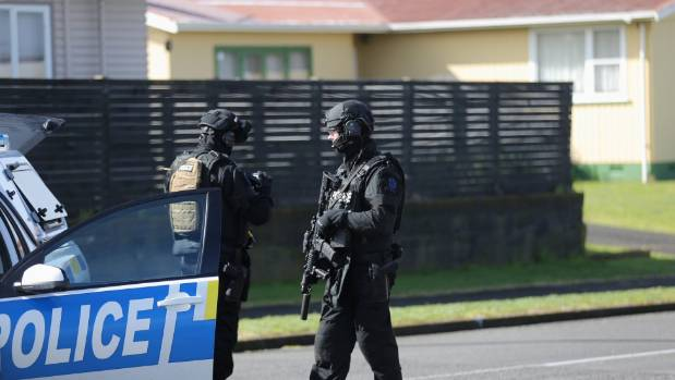 Armed police at the Puriri St cordon after a man was shot dead Tuesday morning.