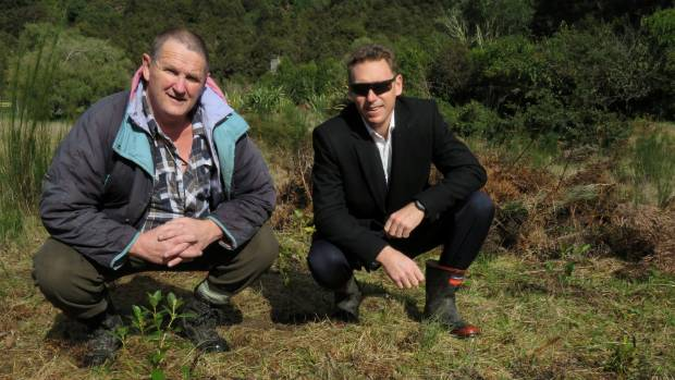 Didymo Dave [left] and Tom Mounsey stand amongst some of the planting done at Hinemaiaia Stream.