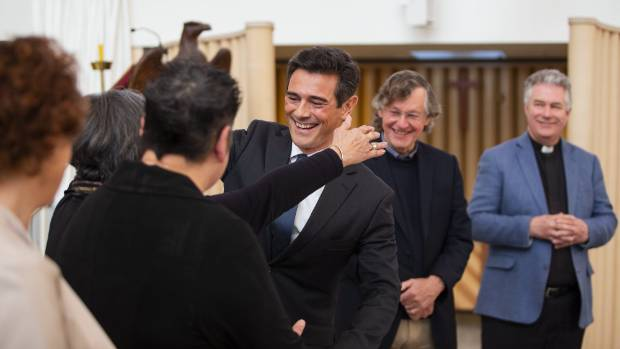 Joint venture chairman Justin Murray cuddles Jenny May from the Christ Church Cathedral Reinstatement Trust after signing the ...