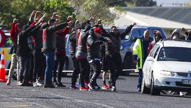 A crowd of Mongrel Mob members say goodbye to their fellow member.