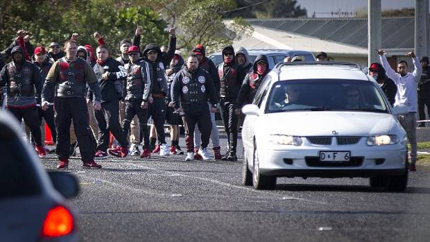 Members perform a rousing haka, while Ratana's body is removed from the scene.