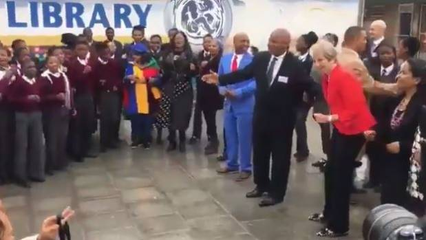 Theresa May Shows Off Her Dance Moves With South African Children