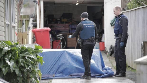 Police on the scene of a serious stabbing in Orewa Grove, Wainuiomata.