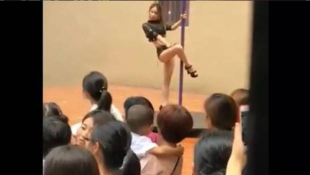 Outrage online after pole-dancing principal greets Chinese kindergartners