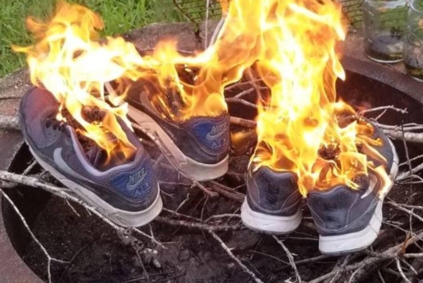 People burn their Nike clothing