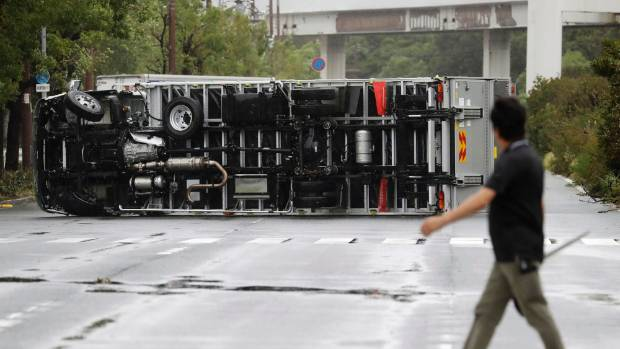 A man looks at a truck overturned in Osaka (file photo).