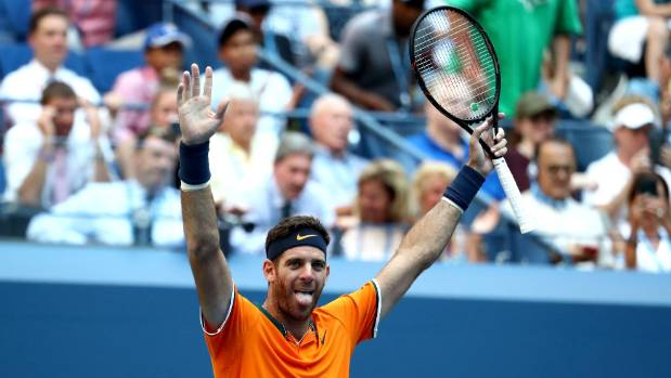 Del Potro beats Isner's serve and the heat