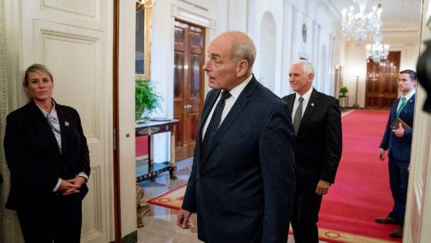 "President Donald Trump's chief of staff John Kelly, centre, reportedly called Trump ""an idiot""."