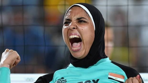 Doaa Elghobashy from Egypt shows delight at winning a point during the beach volleyball at the Rio Olympics.