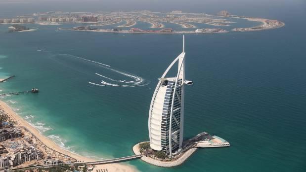 The sail-shaped Burj Al Arab hotel, a symbol of modern Dubai, offers such luxuries as chauffeur-driven Rolls-Royces, ...