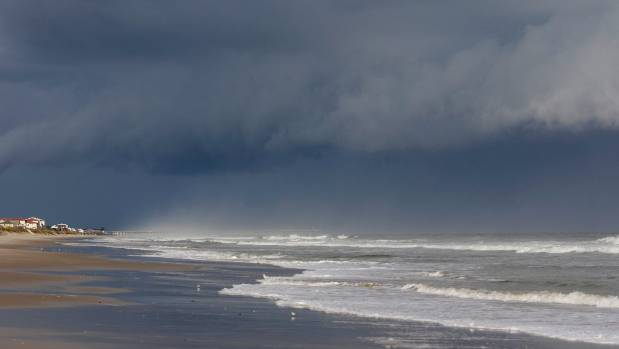 A storm front is seen on the beach in North Topsail Beach North Carolina prior to Hurricane Florence moving toward the