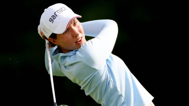 Torres overcomes shaky start to share Evian lead