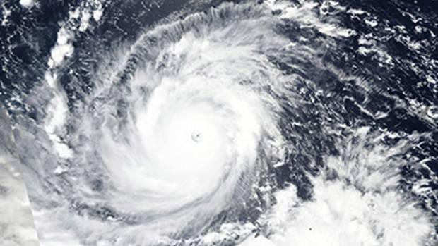 NASA satellite image shows the surging Super Typhoon Mangkhut churn west towards the Philippines.