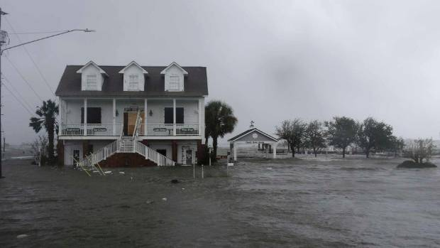 High winds and water surround a house as Hurricane Florence hits Swansboro.