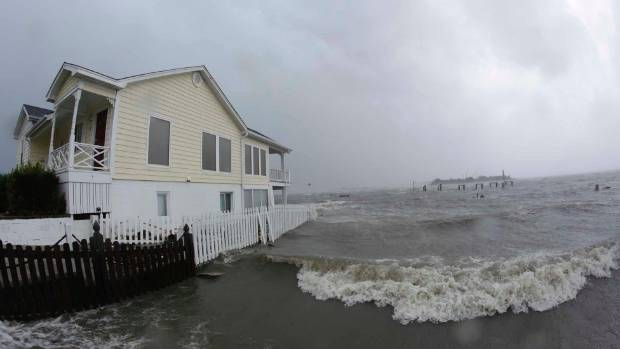 High winds and water surround a house as Hurricane Florence hits.