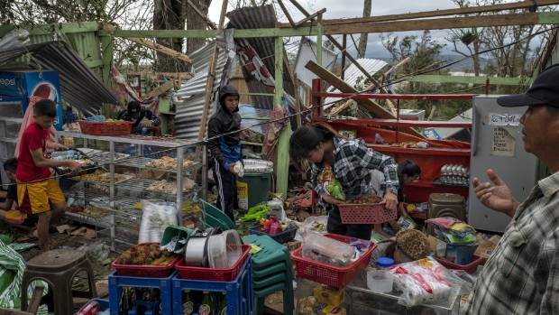 Residents gather usable items after their property was destroyed by Mangkhut.
