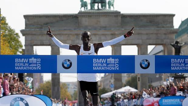 Eliud Kipchoge crosses the line to win the 45th Berlin Marathon and set a new world record in the process