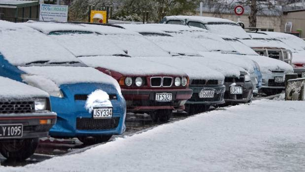 Cars covered in snow in Te Anau.