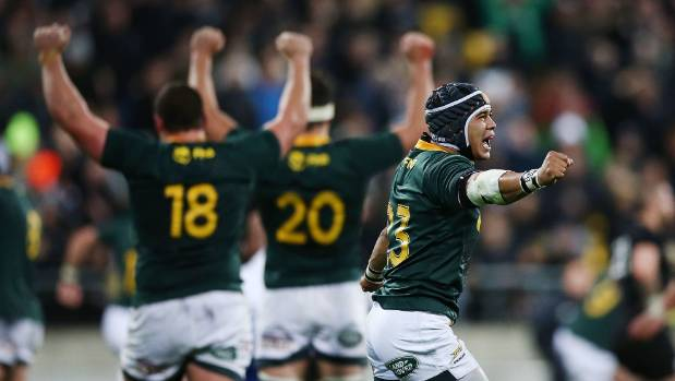 Cheslin Kolbe leads the South African celebrations on Saturday night.