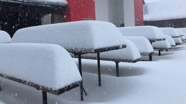 Snowfall on tables at Cardrona Alpine Resort.