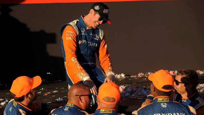79593b09e42 Scott Dixon celebrates with his team in Victory Lane after winning his  fifth IndyCar Series Championship