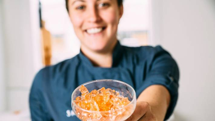 Terri Hendricks, of Snowdog Confectionery, shows off her rose wine gummy bears.