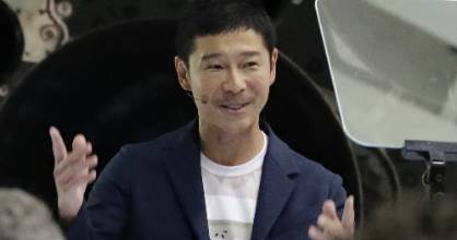 Japanese billionaire Yusaku Maezawa speaks at a press event in California to announce his week-long trip in 2023.