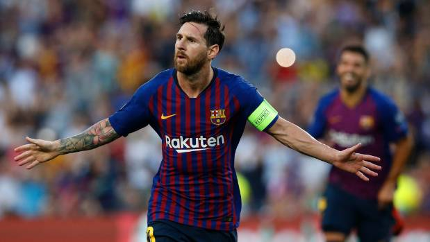 Barcelona forward Lionel Messi celebrates after scoring the first of his three goals