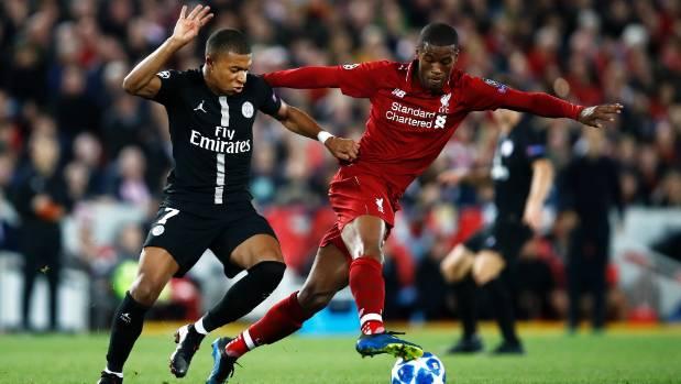Liverpool midfielder Georginio Wijnaldum looks to evade Kylian Mbappe