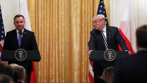 US President Donald Trump looks at Polish President Andrzej Duda as he responds to a reporter's question in the East