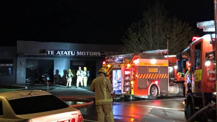 The fire started in Te Atatu Motors, on West Auckland's Te Atatu Peninsula.