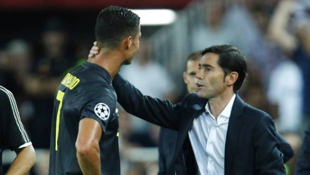 Valencia coach Marcelino Garcia consoles Juventus Cristiano Ronaldo after the latter was sent off