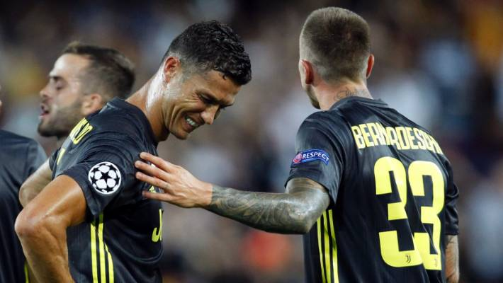 5a2f6c9ef Juventus forward Cristiano Ronaldo is consoled by teammate Federico  Bernardeschi, right, after receiving a