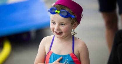 Cochlear implants are no barrier to taking part in swimming lessons for Maisy Taylor, 3.