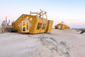 Shipwreck Lodge on the Skeleton Coast in Namibia references the many ships that have foundered on the coast, including ...