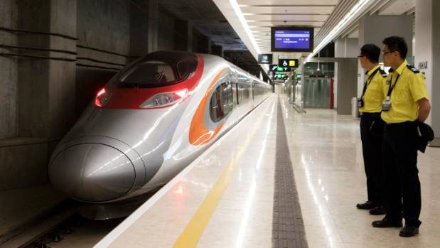 First high-speed train to mainland China departs